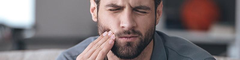 man with sore teeth